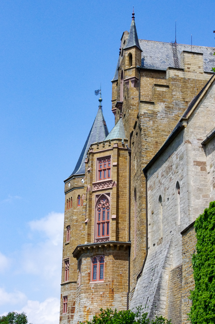 South facade of the Hohenzollern Castle in Germany - Check out roadtripsaroundtheworld.com to find out more