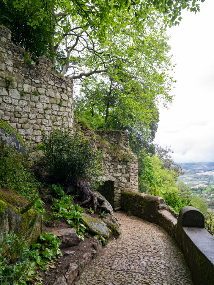 The first gate of the Moors Castle, Sintra - Portugal - Learn more on roadtripsaroundtheworld.com