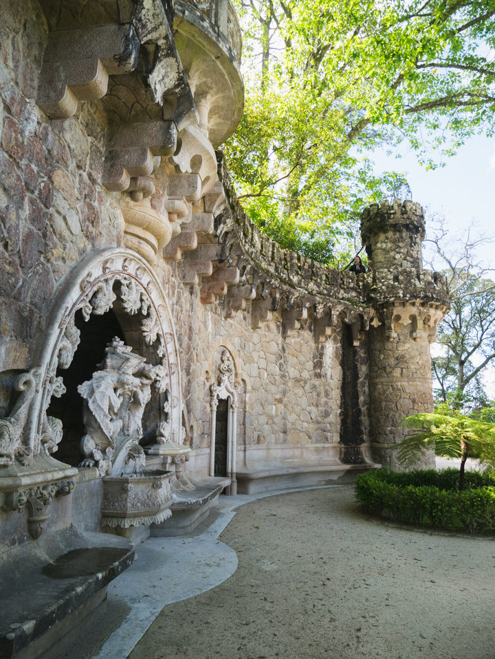 The Portal of the Guardians hidding the entrance of the tunnels - Quinta da Regaleira Palace - Portugal - Learn more on RoadTripsaroundtheWorld.com