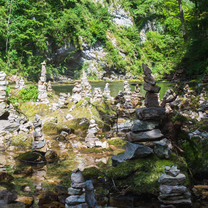 Cairns in the the Vintgar Gorge, Slovenia - Learn more on www.RoadTripsaroundtheWorld.com