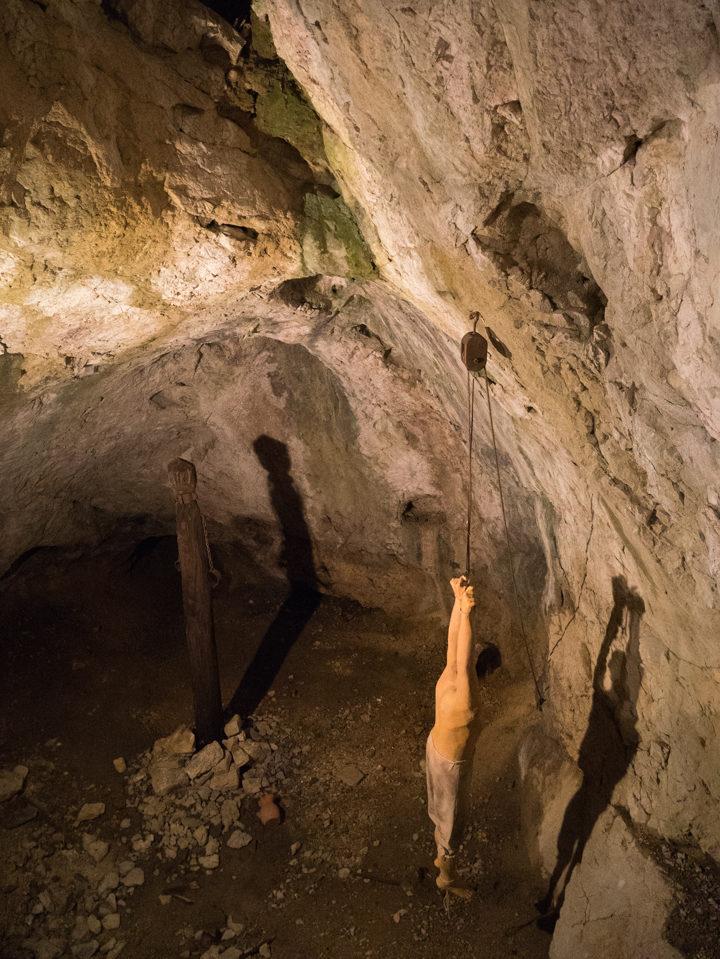 the-prison-torture-chamber-at-the-predjama-castle-slovenia-learn-more-on-www-roadtripsaroundtheworld-com