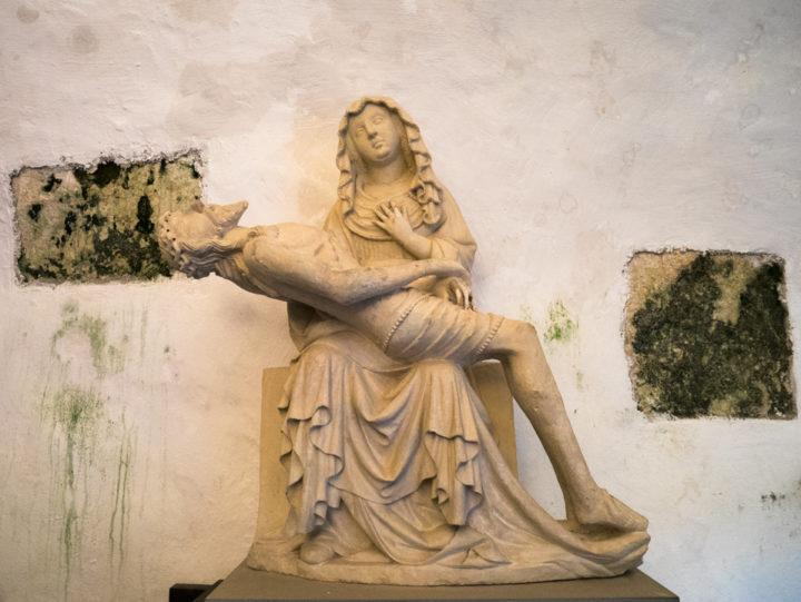 the-statue-in-the-chapel-of-the-predjama-castle-slovenia-learn-more-on-www-roadtripsaroundtheworld-com