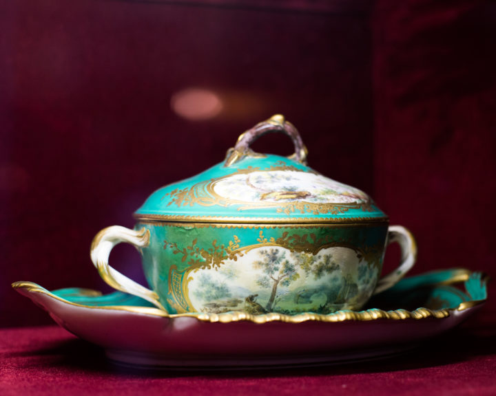 Chateau de Chantilly, France - display of antique porcelain - www.RoadtripsaroundtheWorld.com