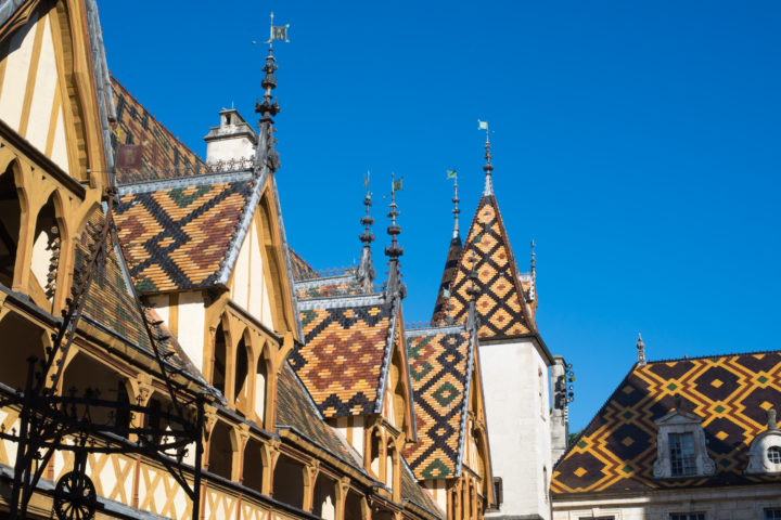 Visit of the Hospices of Beaune, Burgundy - France - The Courtyard tiled roof - www.RoadTripsaroundtheWorld.com