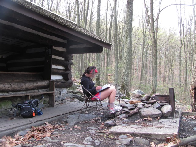 Rocky Run Shelter to Harpers Ferry Sophie reading the trail journal at Rocky Run Shelter