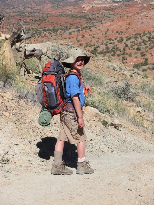 Backpacking Capitol Reef: Garrett Heading Back Down the Chimney Rock Trail