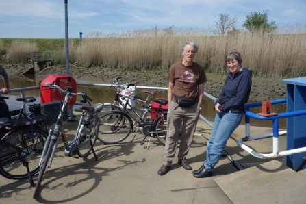 Mom and dad, ready for the free (bike) ferry across the river