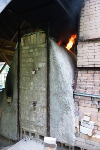 The wood burning kiln in action