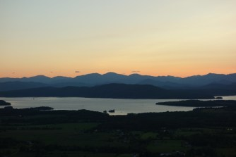 Sunset silhouette of the mountains and the lake