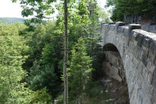 Bridge structure along the rock wall