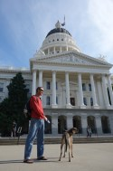 Mark and Herk pose in front of California's Capitol