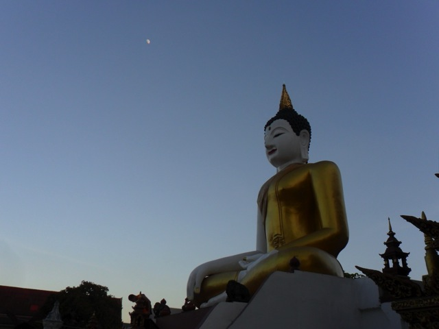 A Buddha statue and temple in Chiang Mai