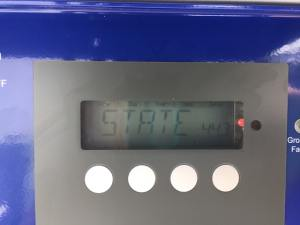 Picture of a Fronius IG inverter showing a red light and a State error code.
