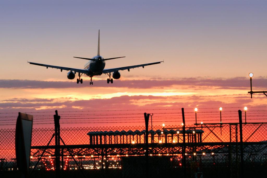 Nok Air - Aeroplane landing at sunset. Rob Gregory Author