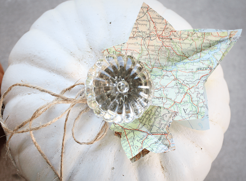 painted faux pumpkin with vintage door knob and map