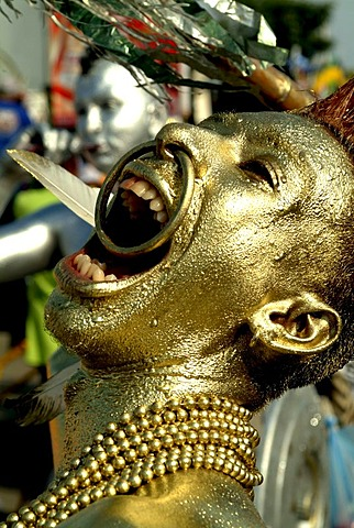 Golden painted man at carnival, Baranquilla, Colombia, South America
