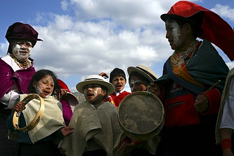 People celebrate during the fiesta of Carnival, in Guamote, Ecuador, on Tuesday, Feb. 28, 2006.