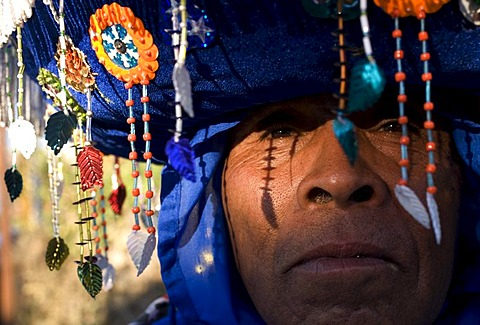 """A Chinelo dancer rests on the sidelines of carnival celebrations in Tlayacapan, Mexico, February 5, 2008.  Groups of Chinelos dance the """"Brinco del Chinelo,"""" or the """"Chinelo Hop"""" during Carnival. Spanish colonizers brought the tradition of Carnival to the"""