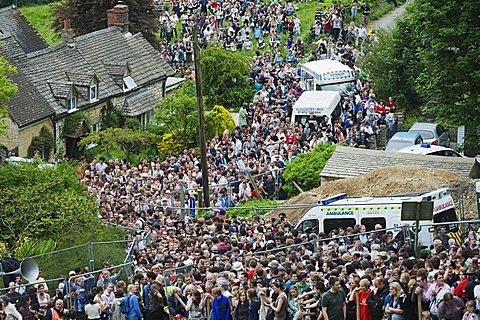 Huge crowds and ambulance crew at the Cheese Rolling Festival, Coopers Hill, Gloucestershire, England, United Kingdom, Europe