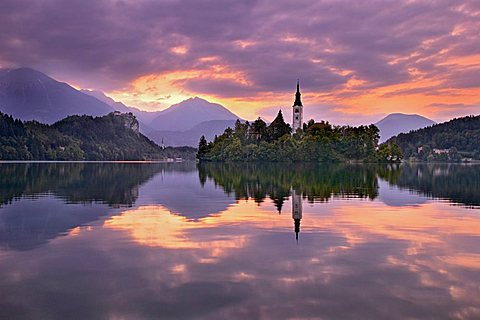 Lake Bled at dawn with Assumption of Mary's Pilgrimage Church, Slovenia, Europe