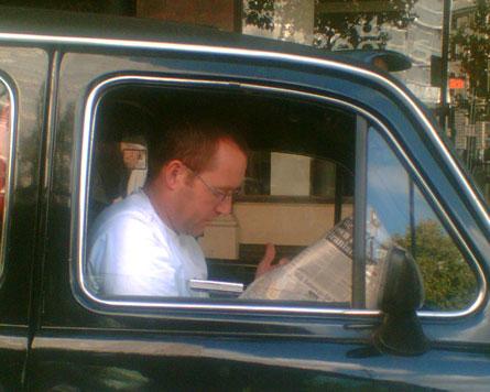 A candid camera shot of a cabbie