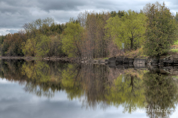 Reflection of the Ottawa River shoreline at Pinhey's Point Heritage Property and Park.