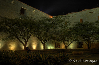 Church and former monastery of Santo Domingo, Oaxaca, Mexico. Night shot of the corner of the courtyard or square outside the church.