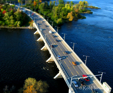 This is a fake tilt-shift of the Champlain Bridge over the Ottawa River between Ottawa, Ontario and Gatineau, Quebec. This is a unique angle of the bridge, obtained through Kite Aerial Photography.