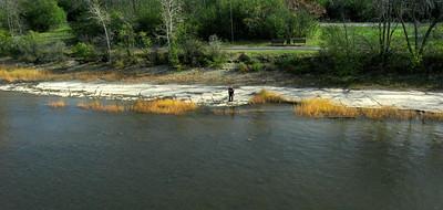 Semi-wild shoreline and habitat along the Ottawa River. Includes kite flying photographer and kite line.