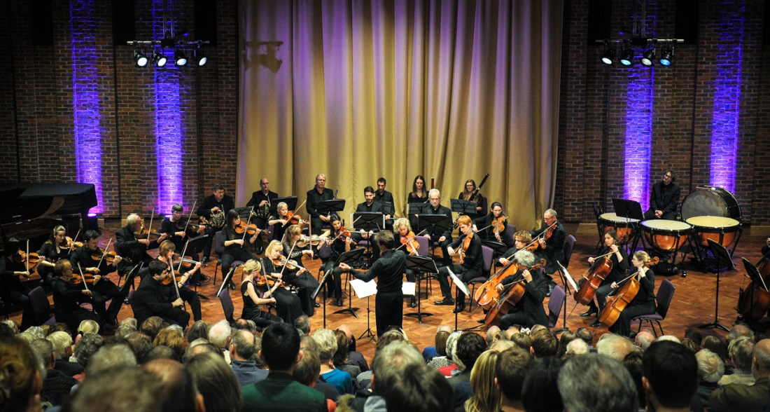 Robin conducts SÓN during their launch concert in front of a sell-out Turner Sims audience