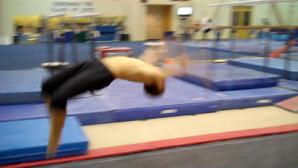 Robin doing a back handspring in gymnastics