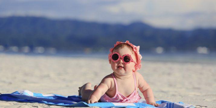 cute baby girl on tropical beach