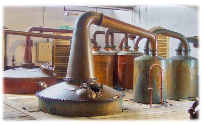 traditional McMillan and Fragasa double retort copper pot stills