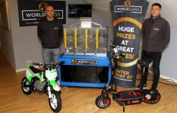From left, best friends Grant Proctor and Jan Wormald with the lottery machine and some of the prizes that will be won through World Class Wins