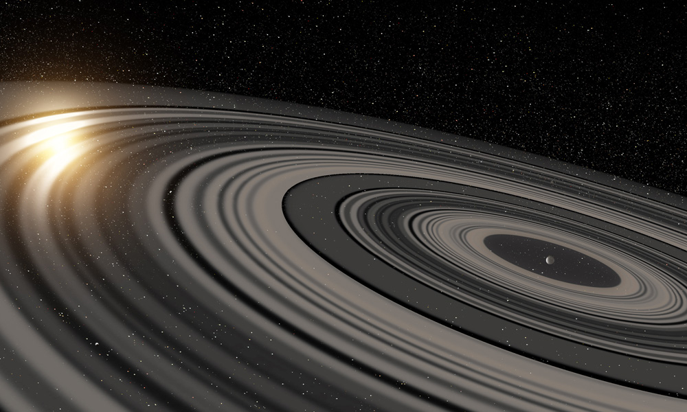 Artist's conception of the extrasolar ring system circling the young giant planet or brown dwarf J1407b. The rings are shown eclipsing the young sun-like star J1407, as they would have appeared in early 2007. Credit: Ron Miller. Taken from the University of Rochester's page