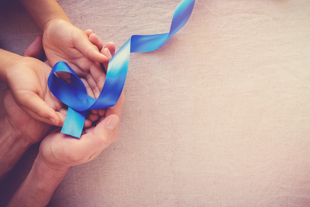 hands with blue ribbon