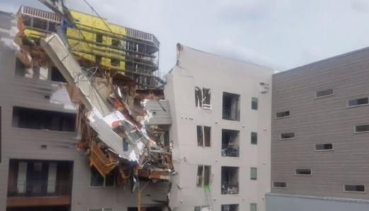 Dallas crane collapses kills one person_1560166009501.jpg.jpg