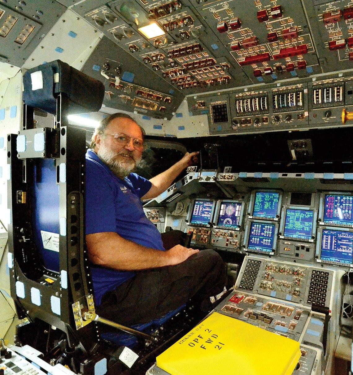 Julian sits on Endeavour's flight deck. Credit: Julian Leek