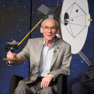 Ed Stone, Voyager project scientist, California Institute of Technology, holds a model of NASA's Voyager spacecraft during a news conference held Sept. 12 to discuss the Voyager 1 spacecraft officially venturing into interstellar space.  Image: NASA/Carla Cioffi