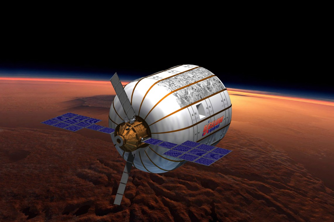 An artist rendering of a BA 330 inflatable space habitat in orbit above Mars. The BA 330 contains 330 cubic meters of volume inside of it. Image: Bigelow Aerospace