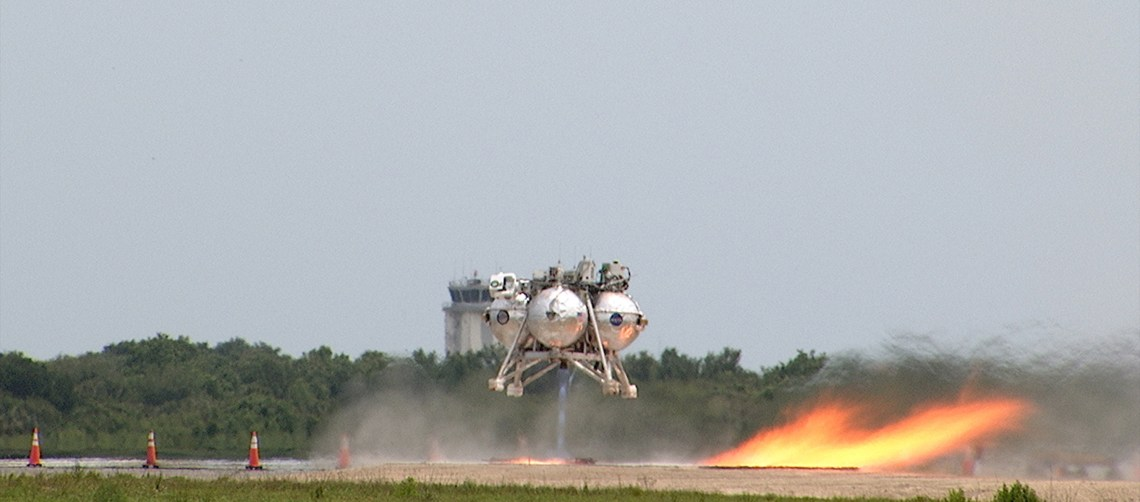 Morpheus lifts off on a 98-second, free-flight test on April 30, 2014. It ascended more than 800 feet at a speed of 36 mph, surveyed the hazard field, then flew forward and downward covering approximately 1300 feet while performing a 78-foot divert before coming to rest inside the hazard field. Credit: NASA/Frankie Martin