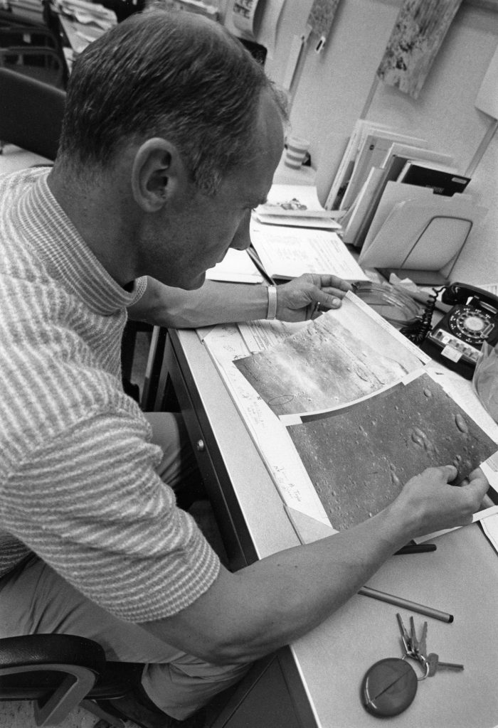 "Edwin ""Buzz"" Aldrin reviews photos of the lunar surface at KSC on July 14, 1969."