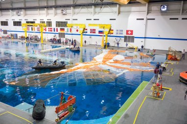 Recovery testing of an Orion main parachute at NASA's Neutral Buoyancy Lab located at JSC. Credit: NASA