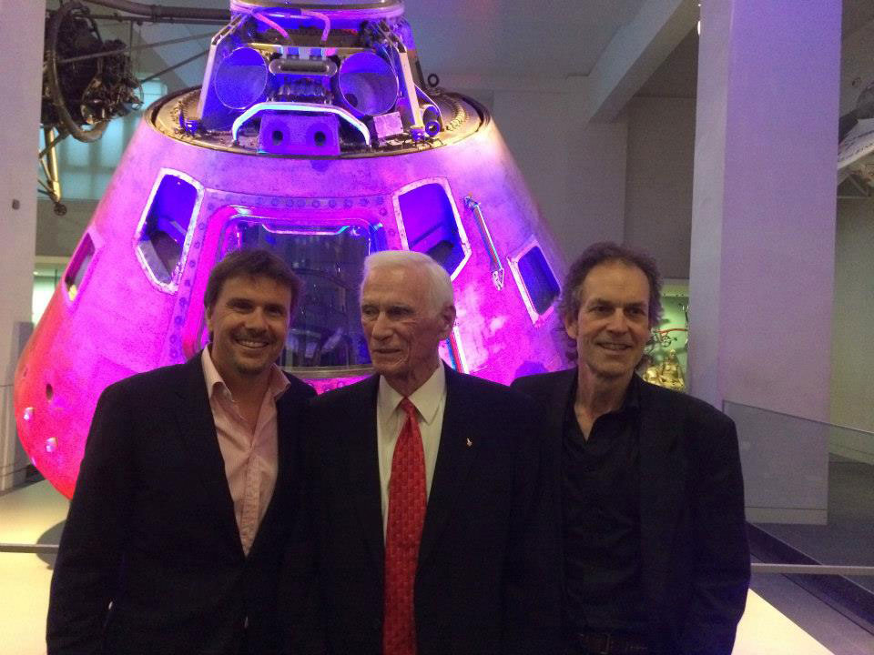 "L-R Executive Producer Mark Stewart, Gene Cernan and Director Mark Craig stand in front of Cernan's Apollo 10 Command Module ""Charlie Brown"" at London's Science Museum. Credit: Mark Stewart Productions"