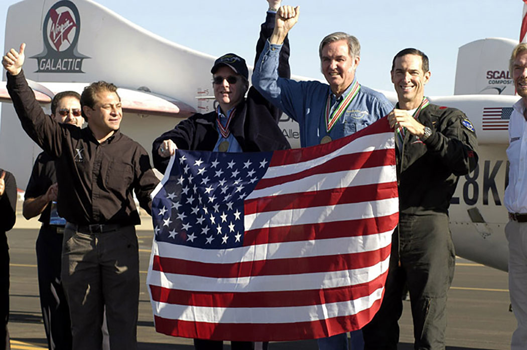 Peter Diamandis, Paul Allen, Burt Rutan and Brian Binnie celebrate. Credit: Don Logan