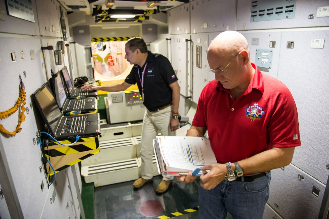 NASA astronaut Scott Kelly (foreground) and Russian cosmonaut Mikhail Kornienko participate in an emergency scenario training session in an International Space Station mock-up/trainer at NASA's Johnson Space Center in Houston, Texas. Credit: NASA/James Blair