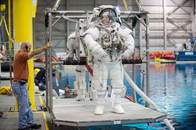 ESA astronaut Timothy Peake, Expedition 46/47 flight engineer, prepares for a spacewalk training session in the waters of the Neutral Buoyancy Laboratory (NBL) at NASA's Johnson Space Center. Credit: NASA/Robert Markowitz