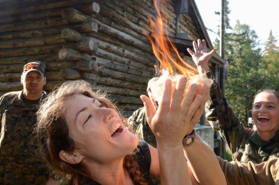 NASA astronaut candidate Christina Hammock starts a fire successfully during wilderness survival training near Rangeley, Maine. Credit: NASA/Lauren Harnett
