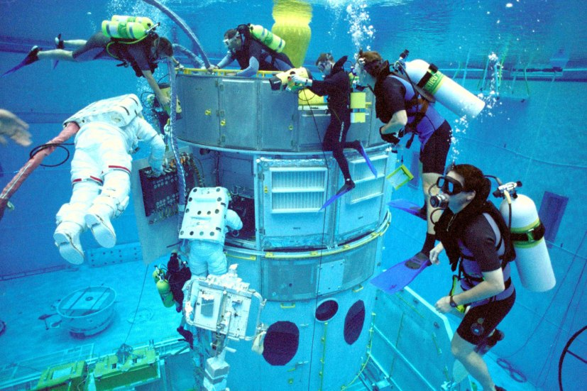 Astronauts train to service Hubble (above) in a huge, water-filled tank that simulates weightlessness. The 40-foot-deep (12 m) tank at NASA's Johnson Space Center contains full-scale underwater mockups of Hubble, its instruments, and the carriers that hold the instruments. The astronauts wear pressurized suits similar to those they wear in orbit. Credit: NASA