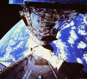 The Hubble Space Telescope exits the cargo bay of Discovery during its deployment on April 25, 1990.  Credit: NASA